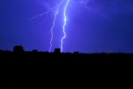 Lightning in the night sky above the city Stock Photo - 10702061