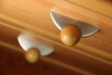 Wood furniture detail, drawer and its knob photo