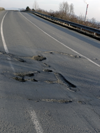 Lot of Potholes in a Old Road photo