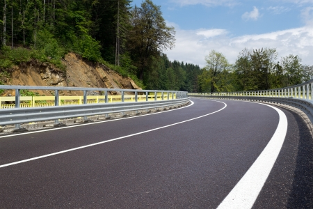 Asphalt twisty mountain road in hills in Slovakia Stock Photo