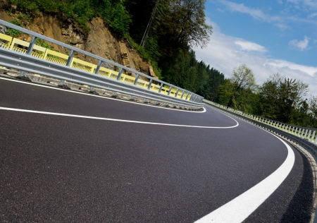 Asphalt twisty mountain road in hills in Slovakia photo