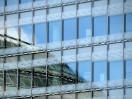 Lot of windows on a modern business buildings photo