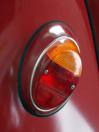 taillight: Dark Red Historical Car, Closeup on Taillight Editorial