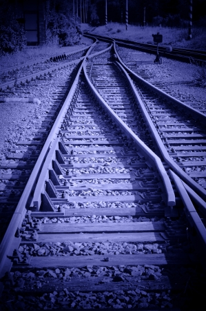 vignetting: Railroad track with switches in blue tone with vignetting Stock Photo