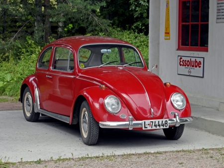 Red historical car (Volkswagen Beetle) in Oslo natural museum on July 27, 2011.
