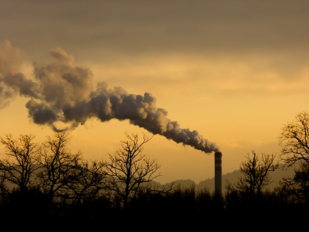 Industrial scene, smoke and high chimney during sunset Stock Photo
