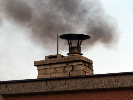 Serious ecological problem, roof and smoking chimney