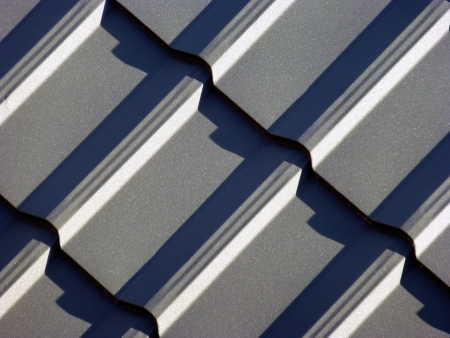 New blue grey roofing from stainless metal plate photo