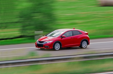 Very fast driving red Japanese modern hatchback photo