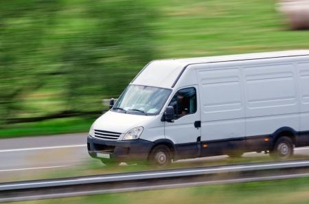 cargo van: Very fast driving white van delivering goods