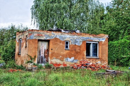 Old destroyed house with a removed roof in HDR photo