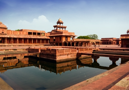 mughal architecture: Fatehpur Sikri mirrored in a water pool in India