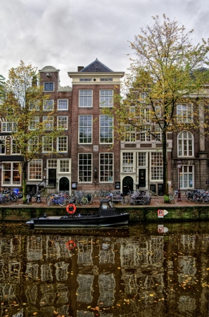 Houses on the bank of river in Amsterdam city photo