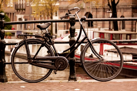 Black bike on the bridge in Amsterdam, Netherlands photo