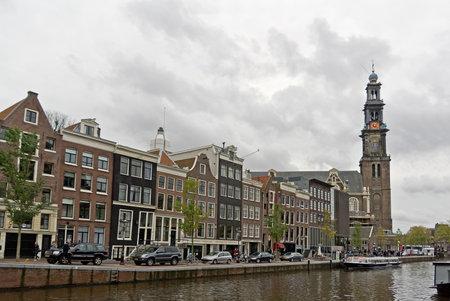 prinsengracht: AMSTERDAM, NETHERLANDS - NOVEMBER 7  Prinsengracht street in Amsterdam, Netherlands with old Western Church taken on November 7, 2013  Editorial