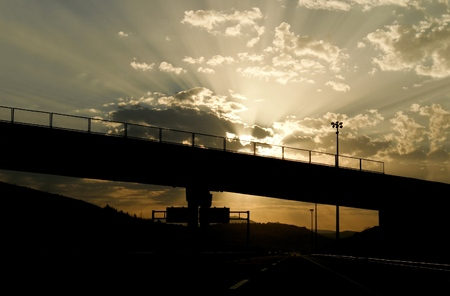 Black silhouette of highway during cloudy sunset photo