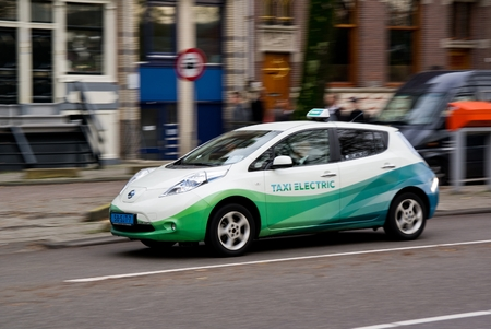 AMSTERDAM, NETHERLANDS - NOVEMBER 8  Nissan Leaf electrical car as a taxi in Amsterdam, Netherlands on November 8, 2013  Taxi Electric operates a fleet of 25 Nissan Leaf electric cars  Editoriali