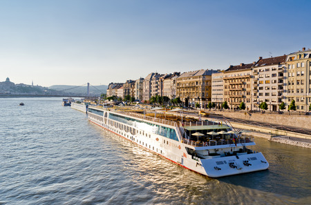 BUDAPEST, HUNGARY - JUNE 17: One of many cruise ships on Danube river in Budapest, capital city of Hungary. The photo was taken on June 17, 2013.