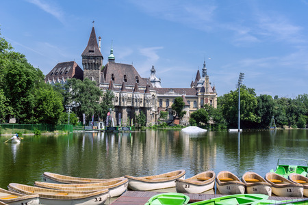 BUDAPEST, HUNGARY - JUNE 19: Famous Vajdahunyad castle reflected in the waters of Varosliget lake. The photo was taken on June 19, 2013.