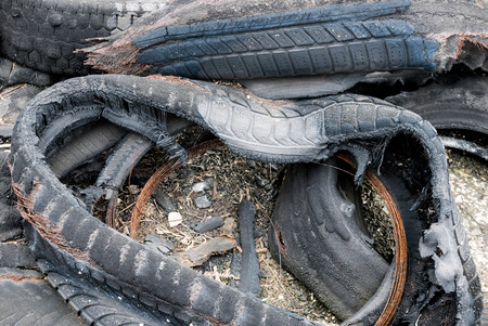 ecological problem: Burned tyres thrown away, huge ecological problem Stock Photo