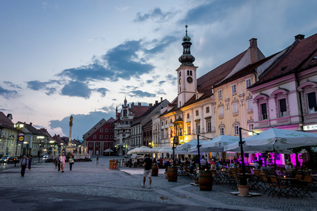 MARIBOR, SLOVENIA - JULY 15: Town hall on a main square in Maribor city, Slovenia during early evening. The image was taken on July 15, 2015.
