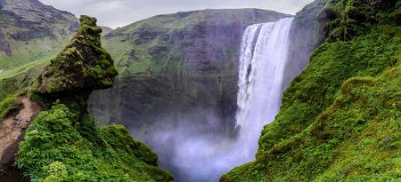 skogafoss waterfall: Panorama of Skogafoss waterfall from a neigbouring hill