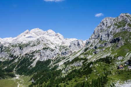dom: Vodnikov dom and landscape of Triglav peak