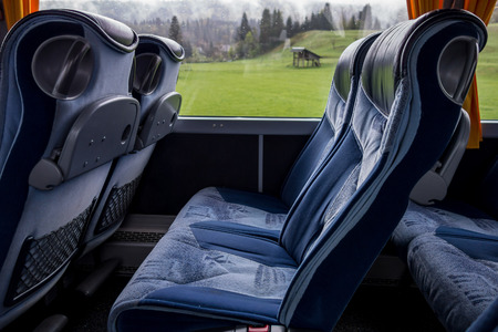 Blue comfortable seats in a luxury bus