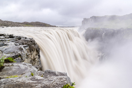 Spectacular Dettifoss waterfall in Iceland after floods filled with muddy water Stock Photo