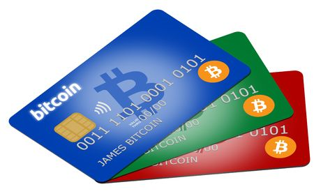 Red, green and blue bitcoin credit or debit cards supporting wireless payments with the popular cryptocurrency