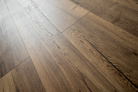Perspective view of dark brown mocca oak floor tiles with daylight reflection 写真素材