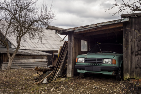 Old stationary eastern european vehicle parked in a wooden shelter