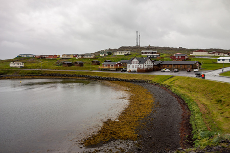 Typical bad cloudy weather in Iceland. Coastline of the Djupivogur city.