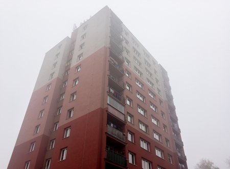 Reconstructed block of flats in Czech Republic built in communism era in misty weather