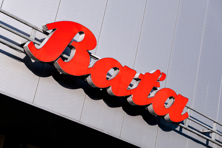 HAVIROV, CZECH REPUBLIC - OCTOBER 24, 2018: Red banner and logo of the Czech shoes company Bata on a grey mall in Havirov.