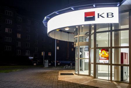 HAVIROV, CZECH REPUBLIC - NOVEMBER 22, 2018: Entrance to the branch of Komercni Banka in Havirov, Czech Republic in late evening hours. The image was taken on November 22, 2018.