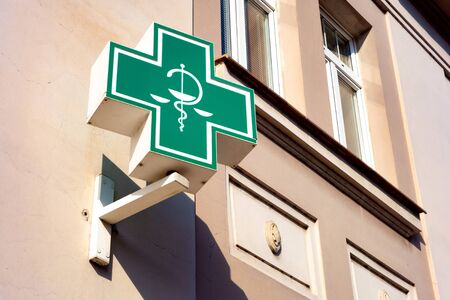 ROUDNICE NAD LABEM, CZECH REPUBLIC - MAY 25, 2019: The typical Czech unified green sign for pharmacies, drugstores and healtcare related shops