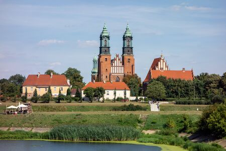 The landscape with the centuries old red brick building of Cathedral of Saint Peter and Paul (Bazylika Archikatedralna pw. sw. Apostolow Piotra i Pawla) in Poznan, Poland