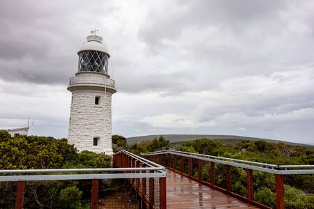 Very old white lighthouse at Cape Naturaliste, Western Australia built in 1903 in overcast weather