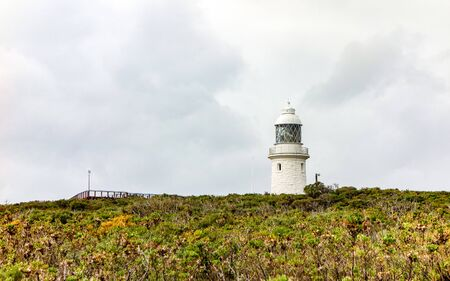 Very old white Cape Naturaliste lighthouse, important landmark in Western Australia Фото со стока