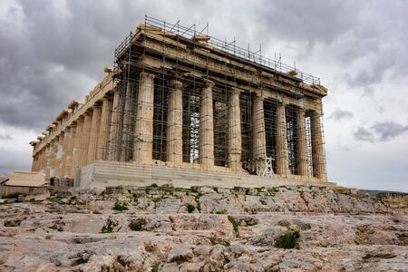 Famous Parthenon at Greek Acropolis under reconstruction in cloudy weather