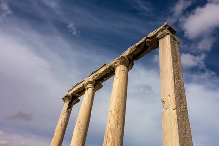 Four columns in Hadrians Library in Athens, Greece against blue sky