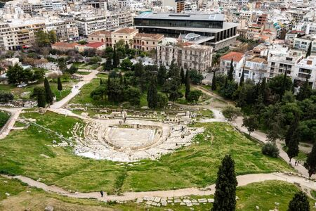 The ruin of the Theatre of Dionysus in Athens, Greece viewed from ancient Acropolis. Stock Photo