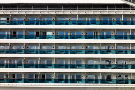 Windows and balconies on an ocean luxury cruise ship as an abstract pattern background