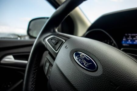 GREECE - FEBRUARY 6, 2019: A close-up shot of steering wheel of a modern Ford Focus car prepared to travel around the country with bokeh effect Editöryel