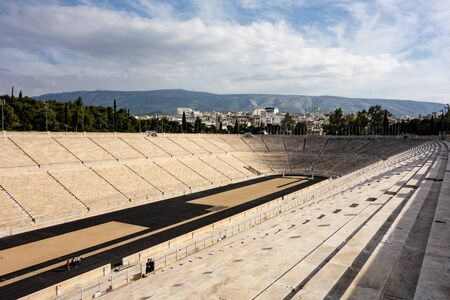 ATHENS, GREECE - FEBRUARY 5, 2019: The famous Kallimarmaro (Panathenaic Stadium) where the first Olympic games were held with runners in strong perspective view Redactioneel