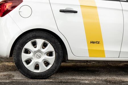 BUGIBBA, MALTA - OCTOBER 27, 2019: Rear side part of a white Opel Corsa hatchback car of the rental company Hertz which is providing these services globally