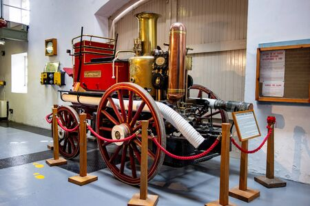 FORRES, SCOTLAND - AUGUST 7, 2019: Historical Glenlossie Fire Engine  as a horse-drawn vehicle displayed at museum in Dallas Dhu Distillery which produces whiskey alcohol