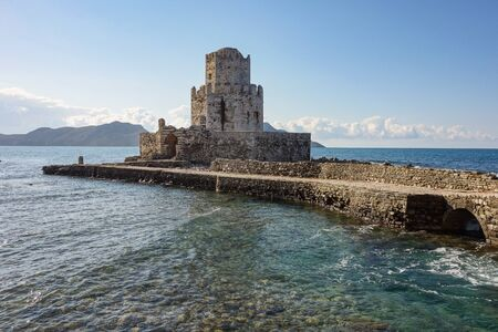 Methoni Castle with a bridge in sunny weather during early morning hours with water waves in Greece