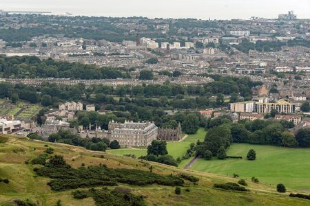 Cityscape of Edinbugrh, Scotland, Great Britain with famous Holyrood House royal residence in the background